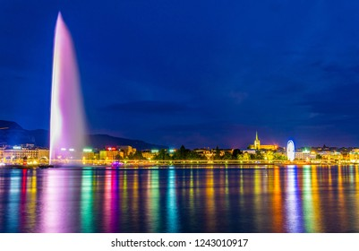 Sunset view of Geneva dominated by Jet d'eau fountain and Saint Pierre Cathedral, Switzerland