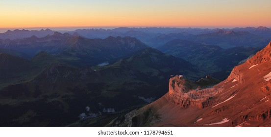 Sunset view from Glacier 3000, Switzerland. Lake Arnen and Saanenland Valley.