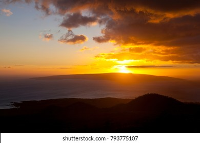 Sunset view from the highway in southern Maui, Hawaii. The island is Kahoolawe, Makena in the foreground.