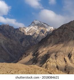 Sunset view of Hindu Kuch snow-capped peak on the Afghan side of the Panj river valley in Ishkashim, Wakhan Corridor, Gorno-Badakshan, Pamir region of Tajikistan - Shutterstock ID 2018084621