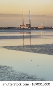 Sunset view of iconic poolbeg power station and Dublin bay