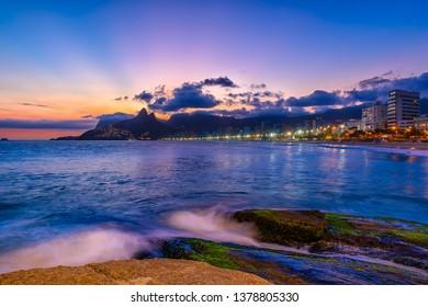 Sunset view of Ipanema beach, Leblon beach and mountain Dois Irmao in Rio de Janeiro, Brazil.Ipanema beach is the most famous beach of Rio de Janeiro, Brazil. Sunset cityscape of Rio de Janeiro