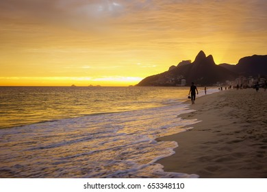 Sunset view of Ipanema beach and mountain Dois Irmao (Two Brother) in Rio de Janeiro, Brazil. Ipanema beach is the most famous beach of Rio de Janeiro