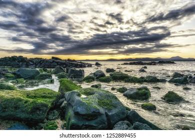 Sunset view of Jeju taken from Udo Sanho Beach also called Seonbinbaeksa. Taken in Jeju Island, South Korea