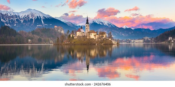 Sunset view of Julian Alps, Lake Bled with St. Marys Church of the Assumption on the small island. Bled, Slovenia, Europe.