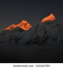 Sunset view from Kala Patthar. Sun lit peaks of Mount Everest and Nuptse, Nepal.