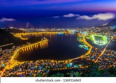 Sunset view of Lagoa Rodrigo de Freitas, Ipanema and Leblon in Rio de Janeiro, Brazil. Night skyline of Rio de Janeiro.