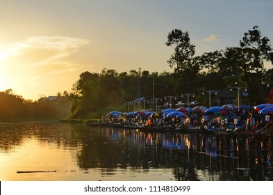 Sunset view at a lake side floating market in Hat Yai, Thailand.