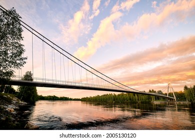 Sunset view of the Lundabron brigde over Ume river in Umeå. The bridg is a suspension bridge with a span of 179 meter opened in year 2019.
