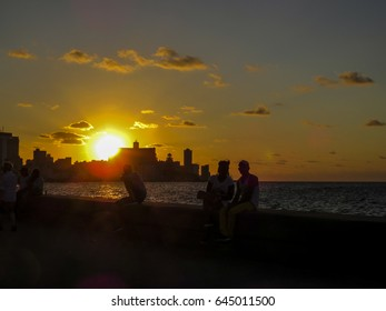 Sunset View of Malecon (El Malecon) seafront boulevard in the Old Havana district with Art Deco and Neo Moorish style buildings. Havana, Cuba