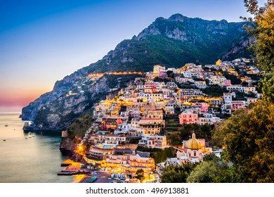 Sunset view of Mediterranean sea and beautiful Positano village at Amalfi Coast, Italy.
