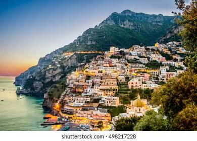 Sunset view of Mediterranean sea and Positano village at Amalfi Coast, Italy.
