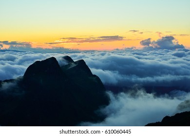 Sunset view with mountain and the fog.