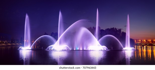 Sunset view of multimedia floating Fountain in Vinnytsia, Ukraine. Built on Southern Buh river