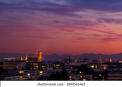 Sunset view of Munich skyline with the Frauenkuirche and the Alps in the background