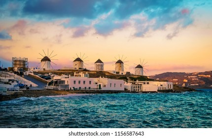 Sunset view of Mykonos seafront with windmills