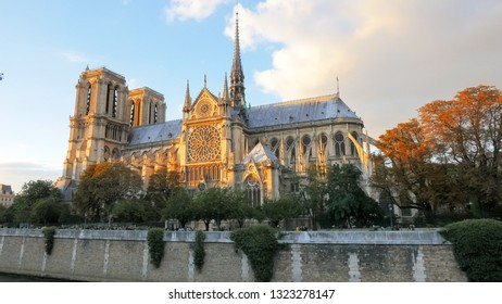 sunset view of the notre dame cathedral in paris