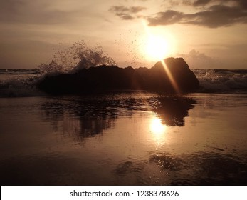 Sunset View With Ocean Waves Hitting Rocks At Batu Bolong Beach, Canggu Village, Badung, Bali, Indonesia