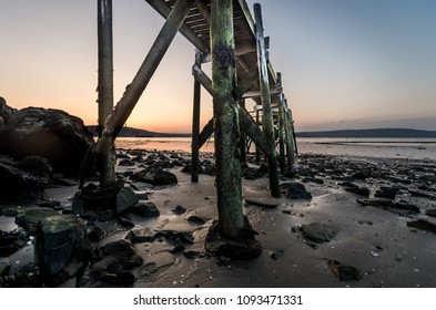 A sunset view of the old Holywood Pier.