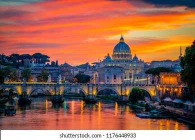 Sunset view of old Sant' Angelo Bridge and St. Peter's cathedral in Vatican City, Rome.Italy