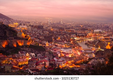 sunset view of old Tbilisi , Georgia , photo from hill ,show peach bridge ,