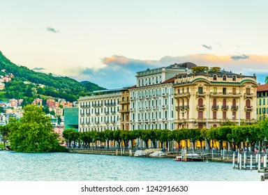 Sunset view of old town of Lugano facing the Lugano lake in Switzerland