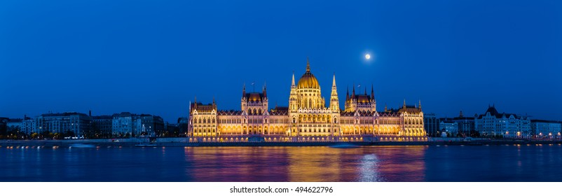 Sunset view on Budapest Parliament with full moon