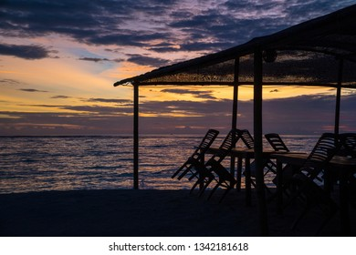 Sunset view on a closed beach restaurant. The end of season concept