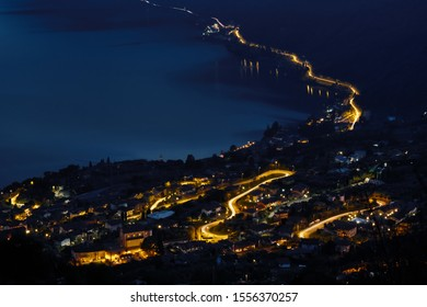 Sunset view on Lake Iseo, Bergamo, Italy. Lights are from Riva di Solto, a little town grown on the lake
