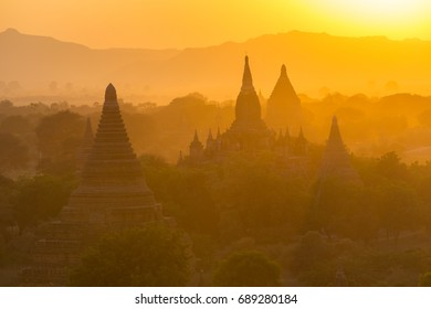 Sunset view on silhouetted pagodas from Shwesandaw paya in Bagan, Myanmar. Bagan is an ancient city with thousands of Buddhist temples and stupas.