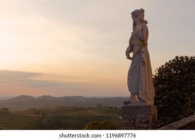 Sunset view of one of the neoclassic female marble statue on the terrace of Rosazzo abbey in the Friuli region, Italy