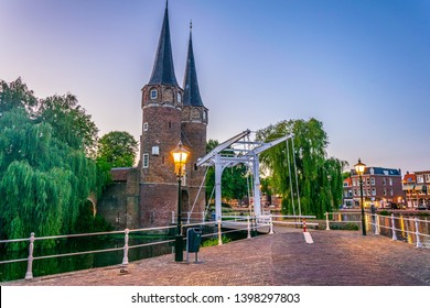 Sunset view of Oostpoort gate leading to the Dutch city Delft, Netherlands