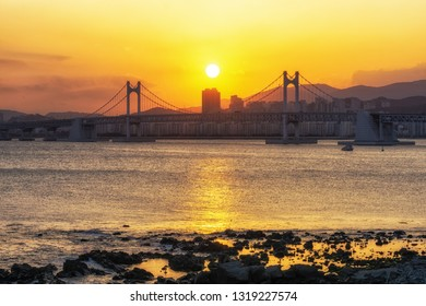 The sunset view over Busan Gwangandaegyo bridge. The famous bridge in busan stretches over 7.4km and is an iconic attraction. Busan, South Korea