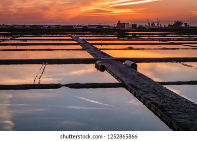 Sunset view over the salt flats of Aveiro, Portugal.