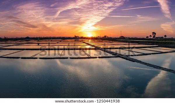 Sunset view over the salt flats of Aveiro, Portugal.