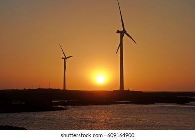 a sunset view over a sea at Sinchang Windmill Coast,jeju island,korea,asia