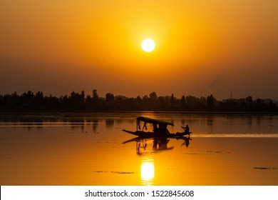 Sunset view over traditional boat or shikara - a type of wooden boat. Shikara are of varied sizes and are used for multiple purposes, including transportation of people.