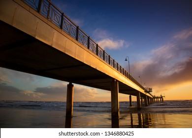 Sunset view of the pier of Marina di Pietrasanta in Versilia Tuscany Italy
