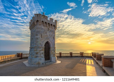 Sunset view of Piombino piazza bovio lighthouse and Elba Island. Maremma Tuscany Italy