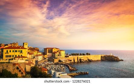 Sunset view of Piombino piazza bovio lighthouse. Maremma Tuscany Italy
