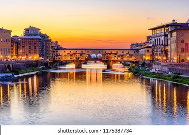 Sunset view of Ponte Vecchio over Arno River in Florence, Italy. Architecture and landmark of Florence. Night cityscape of Florence
