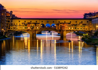 Sunset view of Ponte Vecchio over Arno River in Florence, Italy. Florence architecture. One of the main landmarks in Florence. Night Florence