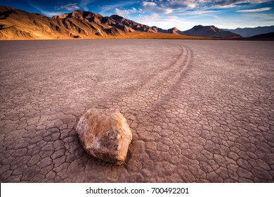 """sunset view of The Racetrack Playa, or The Racetrack, is a scenic dry lake feature with """"sailing stones"""" that inscribe linear """"racetrack"""" imprints."""
