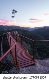Sunset view of red bridge in Fafiao viewpoint and mountains in Peneda Geres National Park.