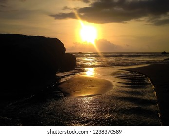 Sunset View With River Beach Flow And The Rocks At Batu Bolong Beach, Canggu Village, Badung, Bali, Indonesia