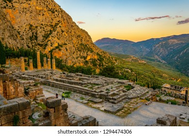 Sunset view of ruins of temple of Apollo at ancient Delphi, Greece