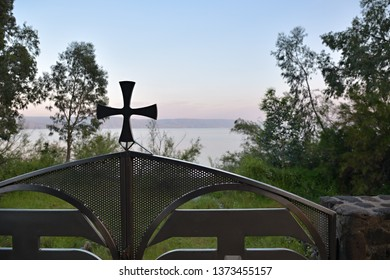 Sunset view of the Sea of Galilee, Lake Tiberias, from garden in The Greek Orthodox Church of the Twelve Apostles in Capernaum, Israel