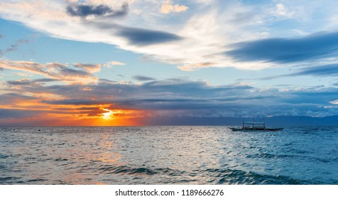 Sunset view of the sea in Moalboal, Cebu, Philippines. Copy space for text