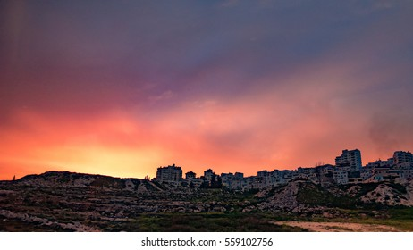 Sunset view with silhouette of buildings at Jericho enroute to Jerusalem, Palestine