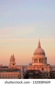 Sunset view of St Paul's Cathedral, dramatic orange colored sunset view present over blue sky.